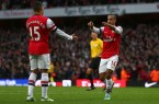 Theo Walcott goes to Alex Oxlade-Chamberlain to thank him for the assist that set up his late goal versus Tottenham.