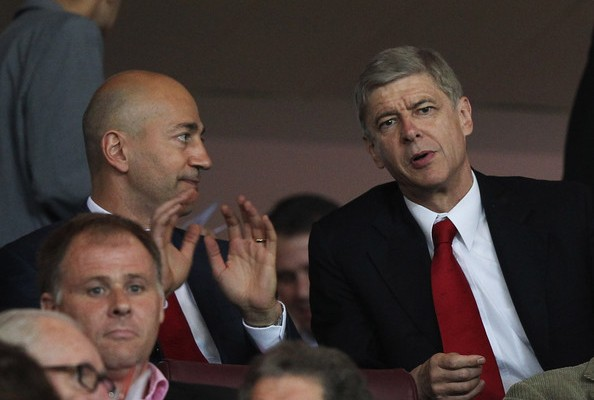 Ivan Gazidis and Arsene Wenger chatting in the stands during the Arsenal v Olympiakos Champion's League tie.