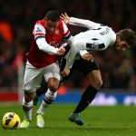 Alex Oxlade-Chamberlain clashes with Davide Santon