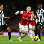 Jack Wilshere breaks away from Sylvain Marveaux and Cheik Tiote