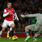 Lukas Podolski runs with the ball