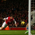 Olivier Giroud heads in Arsenals fifth goal