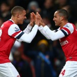 Theo Walcott celebrates scoring his hat trick