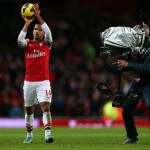 Theo Walcott holds the matchball after scoring a hatrick