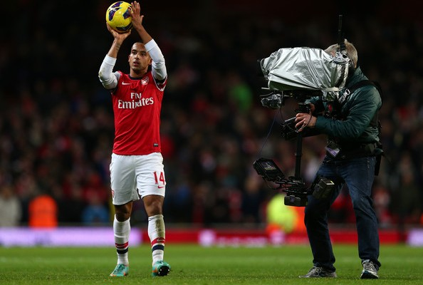 Theo Walcott of Arsenal holds the matchball after scoring a hatrick