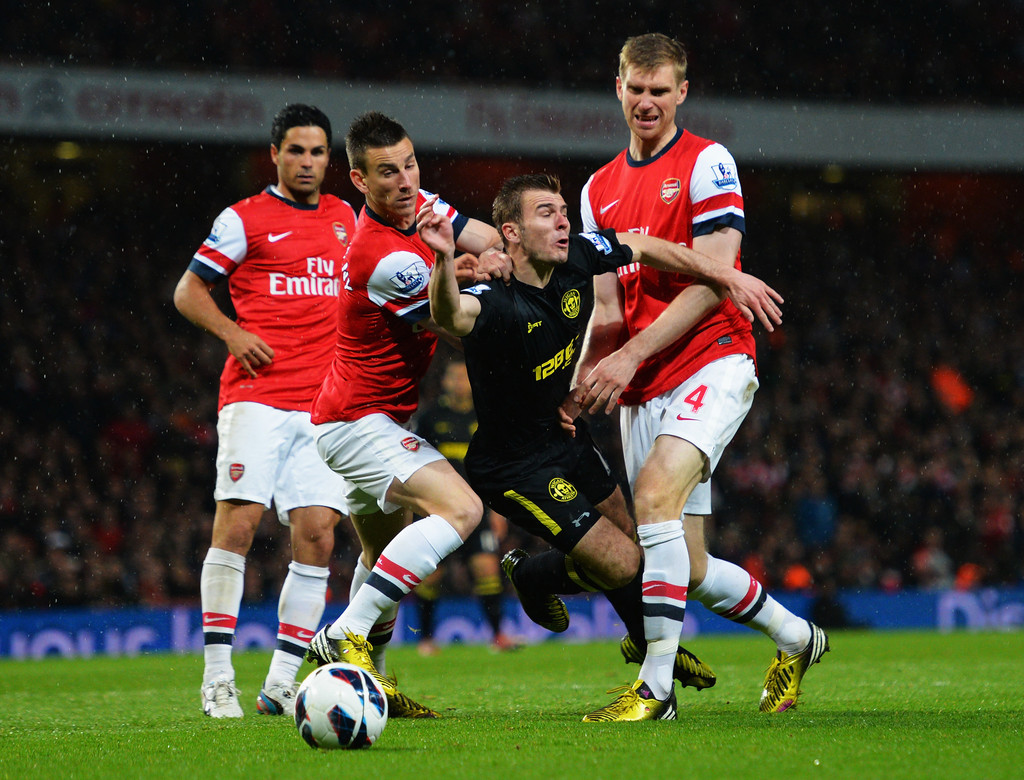 Mertesacker and Koscielny working together
